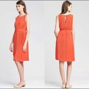 Pleated coral dress